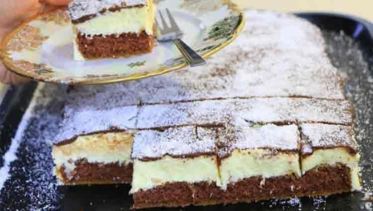 Prăjitură pufoasă și moale, cu nucă de cocos și glazură de ciocolată – Se prepară din 5 linguri făină, 4 ouă, 1 litru de lapte și…